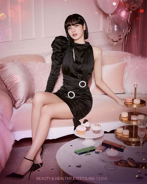 Tags: K-Pop, Black Pink, Lisa, Black Dress, Bare Legs, Black Outfit, Contact Lenses, Medium Hair, Black Footwear, Sitting On Couch, Bare Shoulders, Shoes