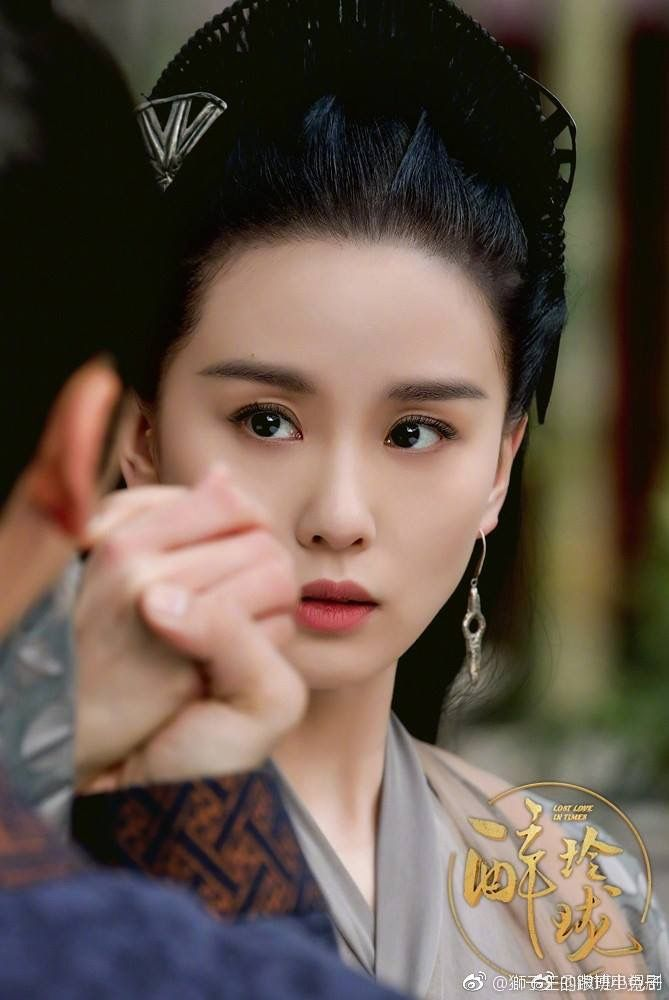 Tags: C-Drama, Liu Shishi, Earrings, Logo, Serious, Chinese Text, Black Eyes, Text: Series Name, Text, Lost Love In Times