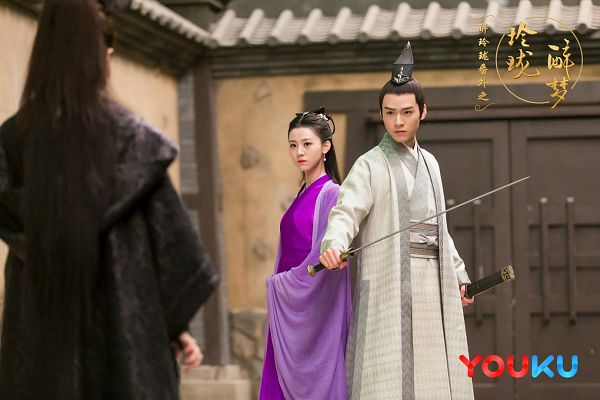 Tags: C-Drama, Xu Muchan, Gong Jun, Purple Outfit, Sword, Duo, Purple Dress, Traditional Clothes, Chinese Clothes, Serious, Hat, Chinese Text