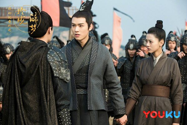 Tags: C-Drama, Xu Muchan, Gong Jun, Cape, Hair Up, Traditional Clothes, Flag, Single Bun, Brown Outfit, Holding Hands, Chinese Text, Hair Buns