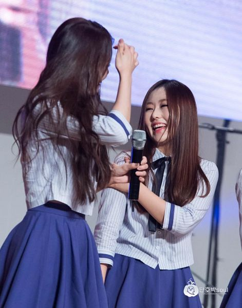 Tags: K-Pop, Lovelyz, Wavy Hair, Striped, Skirt, Blue Skirt, Striped Shirt, Blue Bow, Two Girls, Looking At Another, Bow, Duo