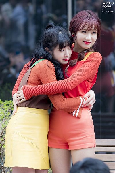 Tags: K-Pop, Lovelyz, Yoo Jiae, Ryu Sujeong, Looking Ahead, Outdoors, Duo, Orange Shorts, Ponytail, Braids, Red Shirt, Yellow Skirt