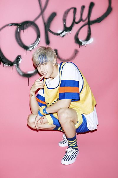 Tags: K-Pop, Got7, Mark, Highlights, Pink Background, Multi-colored Hair, Crouching, Just Right