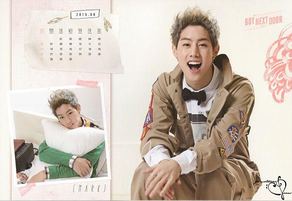 Tags: K-Pop, Got7, Mark, Pillow, Brown Outerwear, Green Shirt, Sitting, Bow Tie, Earrings, Bent Knees, Scan, Wallpaper