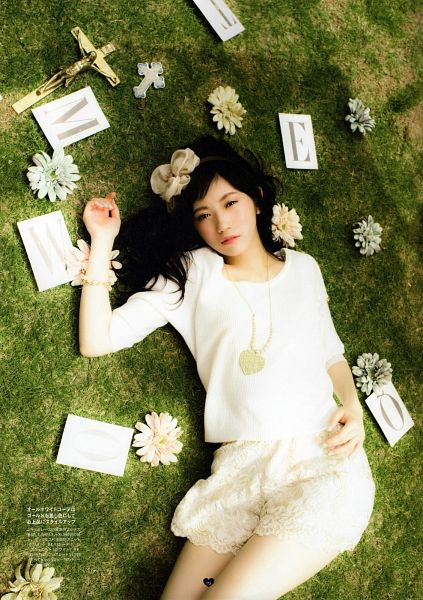Tags: J-Pop, AKB48, Mayu Watanabe, Bare Legs, Laying Down, From Above, Necklace, White Skirt, Skirt, Grass, Looking Up, Flower