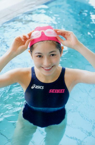 Tags: AKB48, Mayu Watanabe, Hat, Water, Wet, Blue Outfit, Swimming Pool, Arms Up, Swimsuit, English Text, Scan, Seifuku Zukan Saigo no Seifuku Photobook