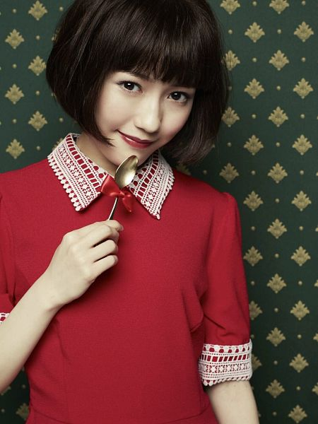 Tags: J-Pop, Mayu Watanabe, Collar (Clothes), Multi-colored Background, Holding Object, Red Lips, Close Up, Wig, Short Sleeves, Blunt Bangs, Red Outfit, Red Dress