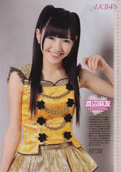 Tags: J-Pop, AKB48, Mayu Watanabe, Japanese Text, Laughing, Yellow Outfit, Sleeveless, Text: Artist Name, Twin Tails, Bare Shoulders, Gray Background, Sleeveless Dress