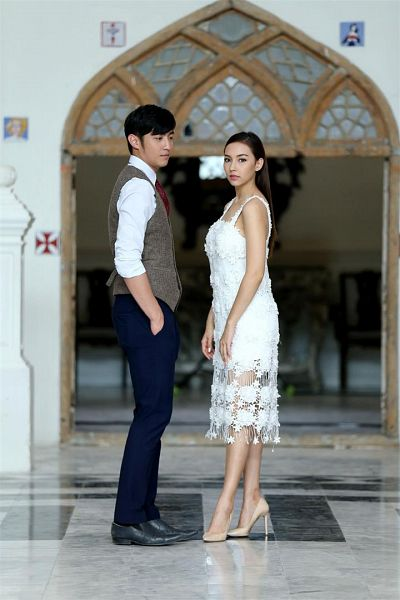 Tags: Lakorn, Chanon Ukkharachata, Carissa Springett, Tie, Looking At Another, Sleeveless, Blue Pants, Full Body, Bare Shoulders, Short Hair, Vest, Hand In Pocket