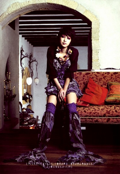 Tags: J-Pop, Mika Nakashima, Hair Up, Purple Legwear, Blue Outfit, Full Body, Black Outerwear, Bare Legs, Sitting On Couch, Couch, Japanese Text, Black Jacket