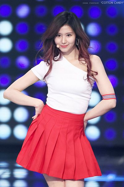 Tags: K-Pop, Twice, Minatozaki Sana, Sleeveless Shirt, Pleated Skirt, Red Skirt, Bare Legs, Sleeveless, Hand On Hip, Bare Shoulders, Blue Background, Collarbone