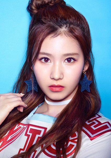Tags: J-Pop, K-Pop, JYP Entertainment, Twice, Minatozaki Sana, Close Up, Multi-colored Shirt, Blue Background, Simple Background, Jewelry, Hair Buns, Earrings
