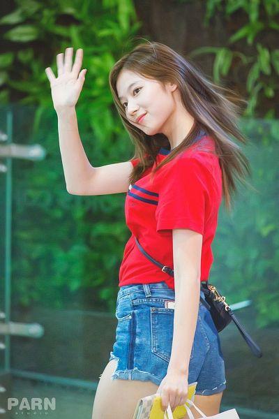 Tags: K-Pop, Twice, Minatozaki Sana, Red Shirt, Wave, Shorts, Walking, Jeans, Denim Shorts, Holding Object, Bag, Looking Away