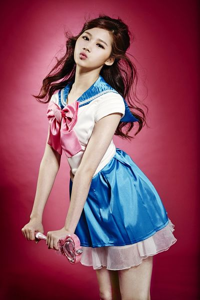 Tags: K-Pop, Television Show, Twice, Sixteen, Minatozaki Sana, Kiss, Sailor Collar, Pink Bow, Red Background, Blue Skirt, Blow a Kiss, Cosplay