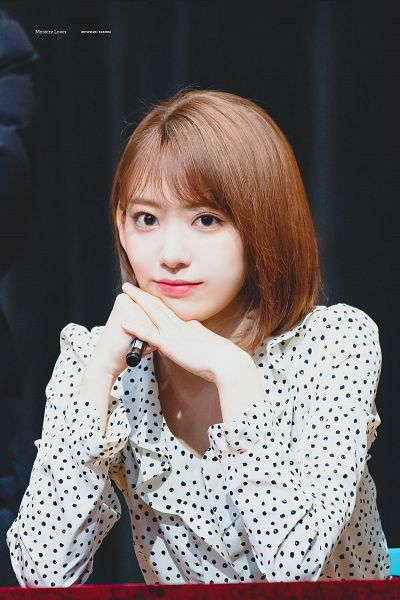 Tags: J-Pop, HKT48, IZ*ONE, Miyawaki Sakura, Chin In Hand, Dark Background, Medium Hair, Spotted, Spotted Shirt, Clasped Hands, Black Background, Pen