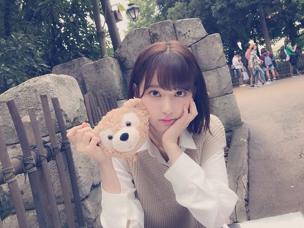 Tags: J-Pop, HKT48, IZ*ONE, Miyawaki Sakura, Stuffed Toy, Brown Outerwear, Hand On Cheek, Toy, Medium Hair, Hand On Head