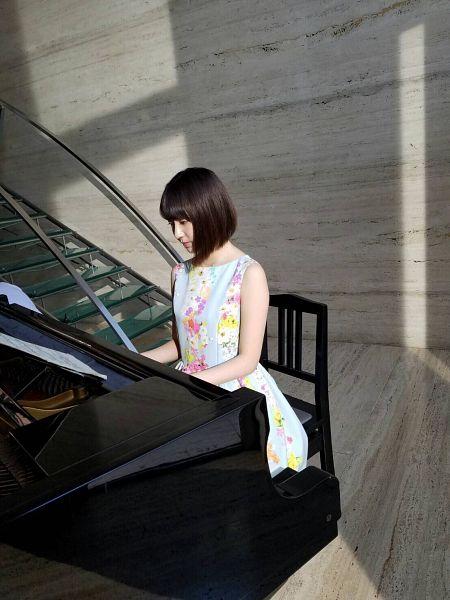 Tags: J-Pop, HKT48, IZ*ONE, Miyawaki Sakura, Floral Print, Medium Hair, Blue Dress, Floral Dress, Bangs, Looking Down, Bent Knees, Stairs