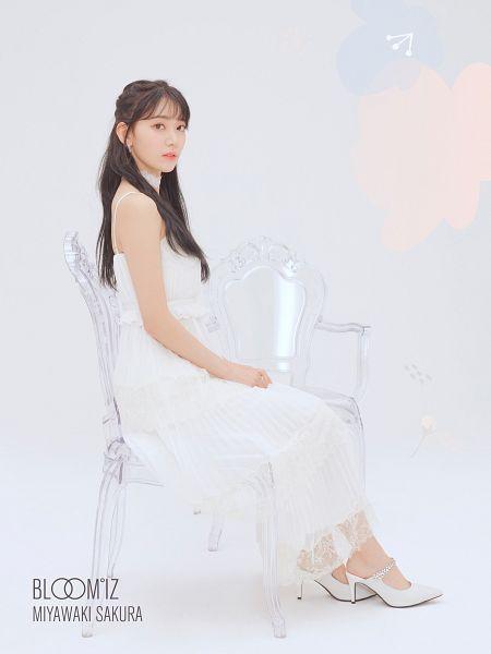 Tags: J-Pop, K-Pop, IZ*ONE, HKT48, Miyawaki Sakura, White Dress, Sitting On Chair, Serious, White Outfit, High Heels, White Footwear, Light Background