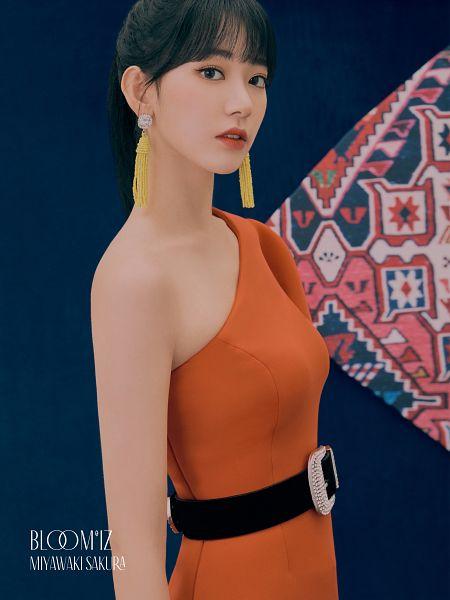 Tags: J-Pop, K-Pop, IZ*ONE, HKT48, Miyawaki Sakura, Hair Up, Orange Dress, Ponytail, Belt, Serious, Blue Background, Orange Outfit