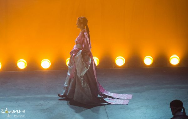 Tags: K-Drama, Girls' Generation, Seohyun, Hanbok, Orange Background, Hair Up, Pink Dress, Pink Outfit, Ponytail, Full Body, Traditional Clothes, Side View