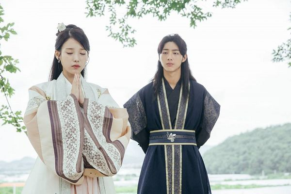 Tags: K-Pop, K-Drama, IU, Ji Soo, Plant, Striped, Striped Outfit, Traditional Clothes, Looking At Another, Clasped Hands, Korean Clothes, Eyes Closed