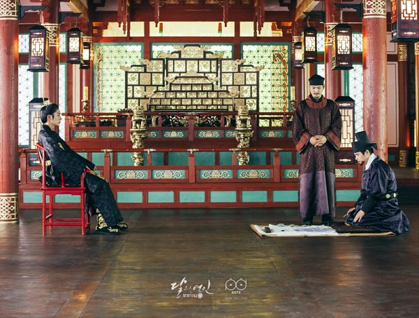 Tags: K-Drama, Kim Sung-kyun, Lee Jun-ki, Belt, Black Outfit, Drawing (Action), Hat, Three Males, Trio, Mustache, Chair, Red Outfit