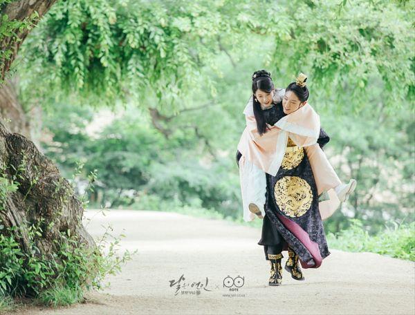 Tags: K-Drama, K-Pop, IU, Lee Jun-ki, Tree, Black Outfit, Holding Close, Piggyback, Jewelry, Single Bun, Couple, Hair Buns