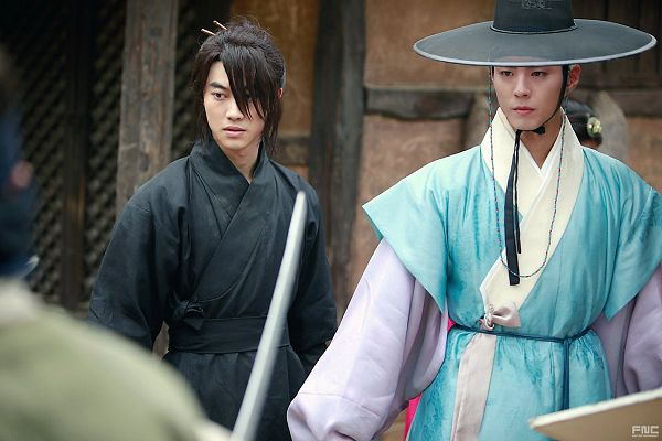 Tags: K-Drama, Kwak Dong-yeon, Park Bo-gum, Hair Up, Weapons, Duo, Ponytail, Sword, Traditional Clothes, Standing, Korean Clothes, Hat