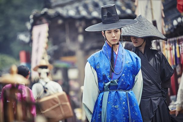 Tags: K-Drama, Park Bo-gum, Kwak Dong-yeon, Two Males, Walking, Blue Outfit, Black Outfit, Duo, Hat, Arms Behind Back, Traditional Clothes, Korean Clothes