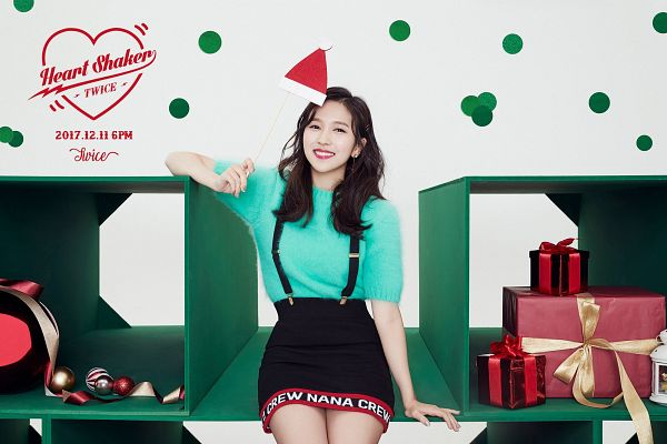 Tags: JYP Entertainment, K-Pop, Twice, Myoui Mina, Wavy Hair, Green Shirt, Holding Object, Text: Calendar Date, Skirt, Red Lips, Text: Song Title, Text: Artist Name