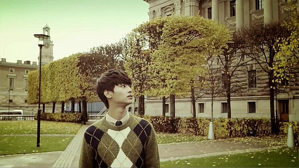 Tags: K-Pop, VIXX, N (singer), Gray Shirt, Sweater, Outdoors, Looking Away, Plant, Tree, Frown, Wallpaper