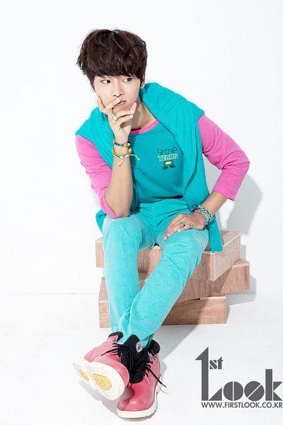 Tags: K-Pop, VIXX, N (singer), Blue Pants, White Background, Blue Outerwear, Hand On Leg, Blue Shirt, Text: Magazine Name, Looking Away, Blue Jacket, Light Background
