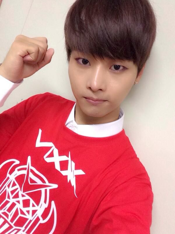 Tags: K-Pop, VIXX, N (singer), Text: Artist Name, White Background, Sweater, Red Shirt, Fist, Light Background