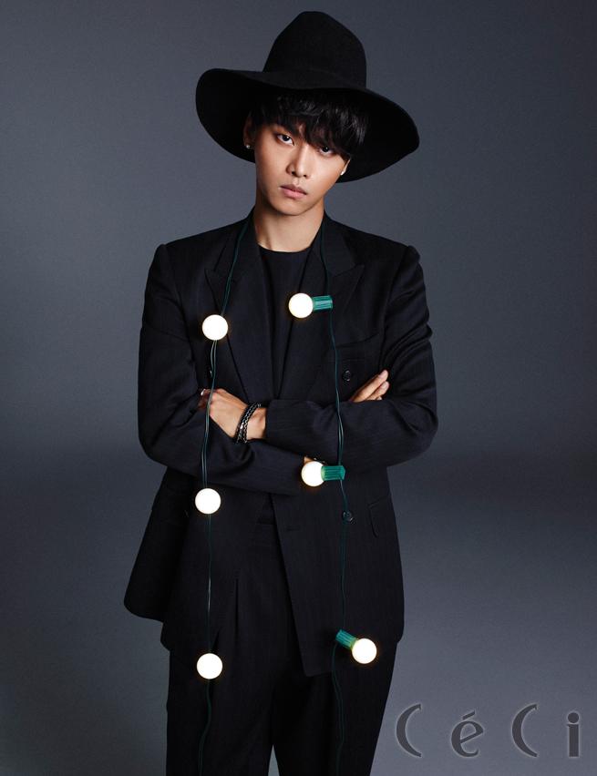 Tags: K-Pop, VIXX, N (singer), Crossed Arms, Hat, Text: Magazine Name, Black Pants, Bracelet, Dark Background, Black Jacket, Black Background, Black Headwear