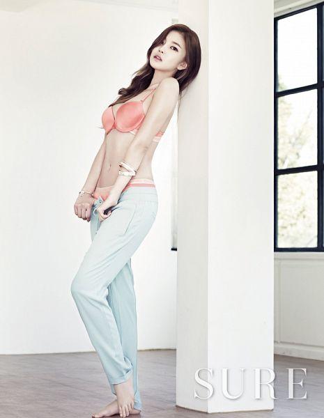 Tags: K-Pop, NS Yoon-G, Bracelet, Midriff, Lingerie, Bare Shoulders, Light Background, Bra, Text: Magazine Name, White Background, Suggestive, White Pants