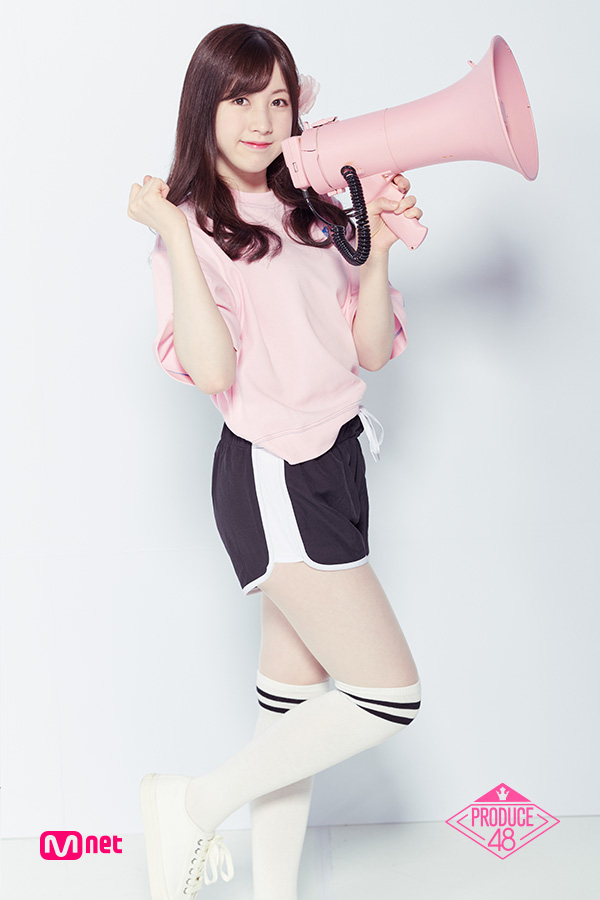 Tags: J-Pop, Television Show, AKB48, Nagano Serika, Light Background, Pink Shirt, White Background, Megaphone, Hair Clip, Text: Series Name, Shorts, Standing On One Leg
