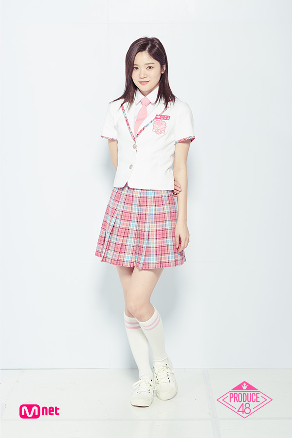 Tags: J-Pop, Television Show, AKB48, Nakano Ikumi, Sneakers, Text: Artist Name, Tie, Collar (Clothes), Arms Behind Back, Light Background, Checkered Skirt, Skirt