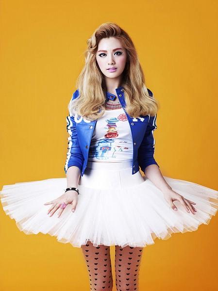 Tags: K-Pop, After School, Orange Caramel, Lipstick (Orange Caramel), Nana, Bracelet, Blue Jacket, Yellow Background, Skirt, Blonde Hair, White Skirt, Ring