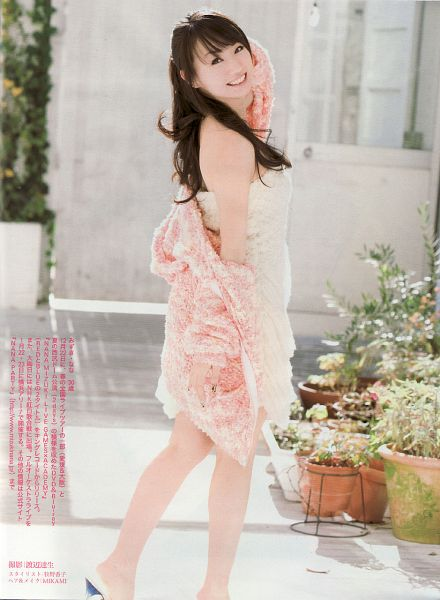 Tags: J-Pop, Nana Mizuki, Sleeveless, Sleeveless Dress, White Outfit, Text: Artist Name, Pink Jacket, Looking Back, Bare Shoulders, Japanese Text, Grin, Plant