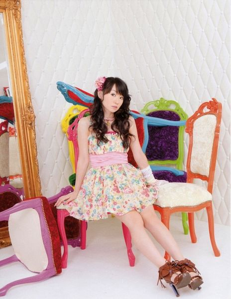Tags: J-Pop, Nana Mizuki, White Background, Floral Dress, Wavy Hair, White Dress, Brown Footwear, Belt, Sitting On Chair, Bare Shoulders, Necklace, White Outfit