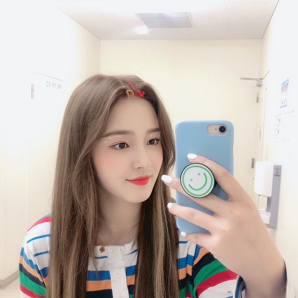 Tags: K-Pop, Momoland, Nancy, Light Background, Nail Polish, White Background, Multi-colored Shirt, Make Up, Looking at Phone, Phone, Striped Shirt, Striped