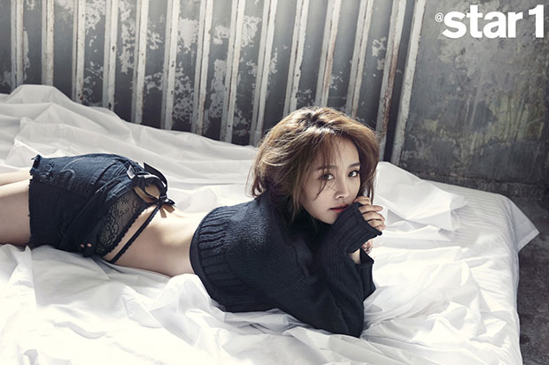 Tags: K-Pop, KARA, Nicole Jung, Laying On Stomach, Text: Magazine Name, Midriff, Black Shorts, Laying Down, Black Shirt, Medium Hair, On Bed, Shorts