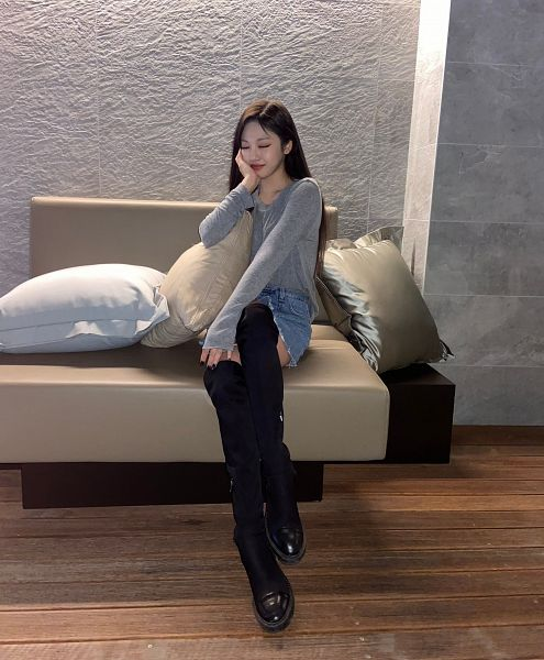 Tags: K-Pop, Aespa, Ningning, Sitting On Couch, Skirt, Hand On Head, Hand On Cheek, Thigh Boots, Gray Background, Pillow, Denim Skirt, Eyes Closed
