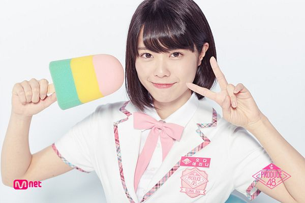 Tags: J-Pop, Television Show, AKB48, Oda Erina, Blunt Bangs, White Outerwear, Uniform, Light Background, V Gesture, Short Sleeves, Text: Series Name, White Background