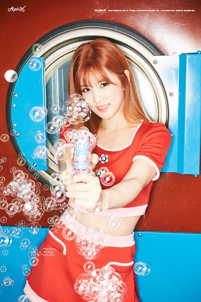 Tags: K-Pop, Plan A Entertainment, Apink, Park Cho-rong, Standing, Bubbles, Red Skirt, Text: Company Name, Text, Red Shirt, Midriff, Text: Artist Name