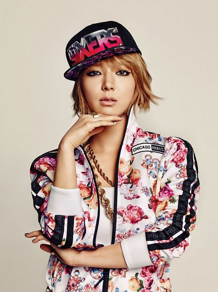 Tags: K-Pop, AOA (Ace Of Angels), Park Choa, White Outfit, Floral Print, Necklace, White Jacket, Floral Jacket, Brown Background, Chin In Hand, Black Headwear, NBA