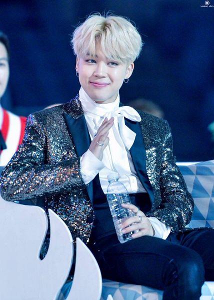 Tags: K-Pop, BTS, Park Jimin, Water, Black Pants, Blonde Hair, Bottle, Ring, Brown Outerwear, Contact Lenses