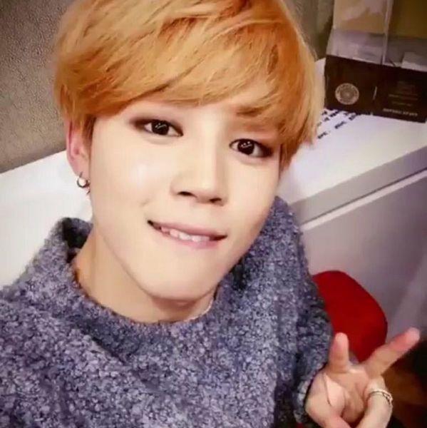 Tags: K-Pop, BTS, Park Jimin, Ring, Black Eyes, V Gesture, Red Hair, Gray Shirt, Grin, Selca