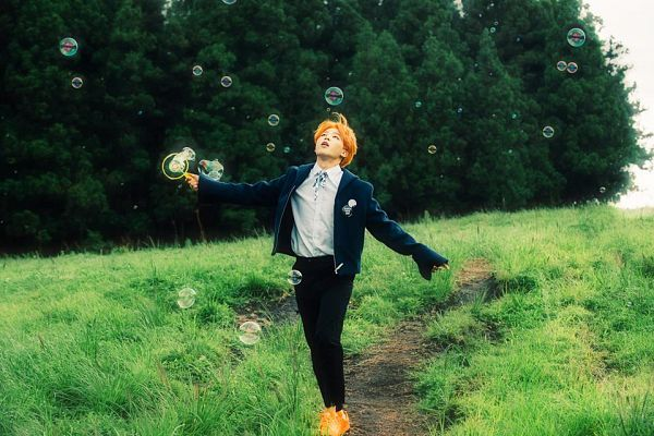 Tags: K-Pop, BTS, Park Jimin, Black Pants, Bubbles, Black Eyes, Black Jacket, Forest, Outdoors, Red Hair, Grass, Looking Up