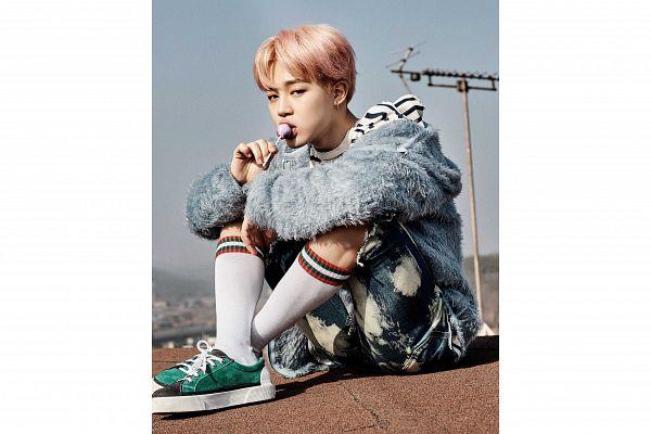 Tags: K-Pop, BTS, Park Jimin, Blue Jacket, Fur, Eating, Blue Outerwear, Lollipop, Green Footwear, Pink Hair, Crossed Legs, Black Eyes